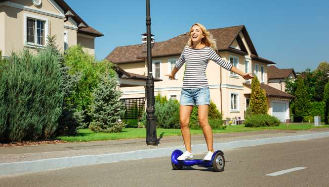 lady riding a hoverboard