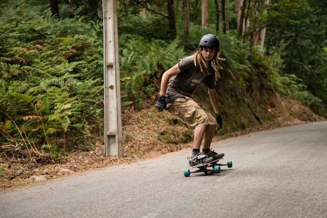 man riding an electric skateboard