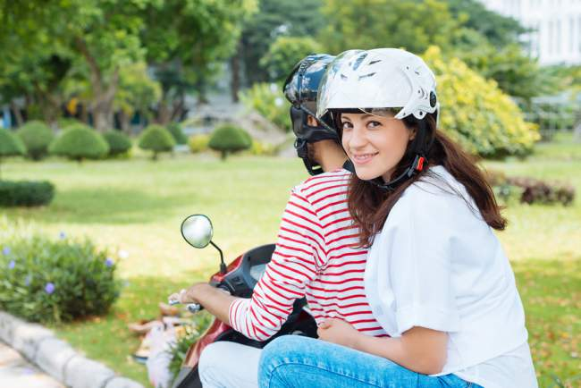 scooter riders wearing helmets